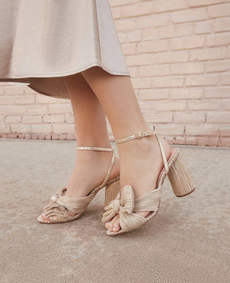 platinum gold high heel sandal worn with midi skirt